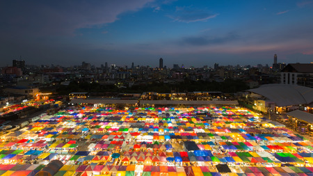 Night market aerial view multiple colour rooftop, Bangkok city downtown background