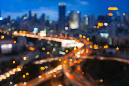Abstract blurred lights highway overpass interchanged with city downtown background Stock Photo
