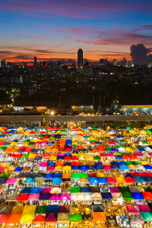 Multiple colour aerial view weekend market with sunset sky background