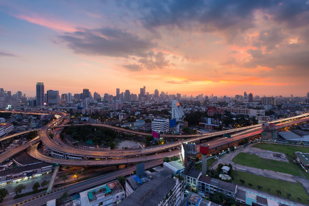 Sunset sky background over Bangkok city and highway interchanged, Thailand Stock Photo