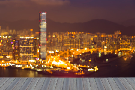 source of light: Opening wooden floor, Hong Kong blurred lights night view abstract background
