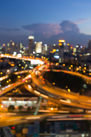 Twilight blurred bokeh lights interchanged with city downtown background Stock Photo