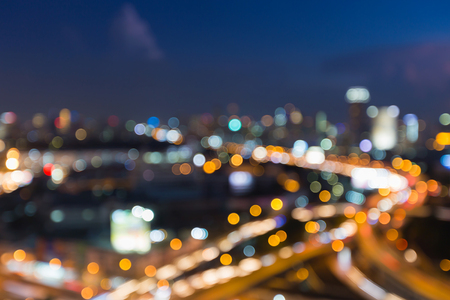 Abstract blurred lights, city downtown and highway road interchanged night view