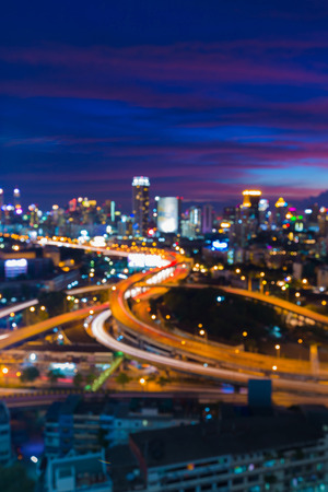 Blurred lights highway interchanged with city downtown with beautiful after sunset sky background Stock Photo