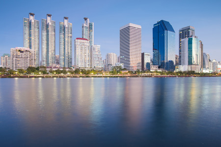 residential construction: City condominium and office building with water reflection over the lake, Bangkok Thailand