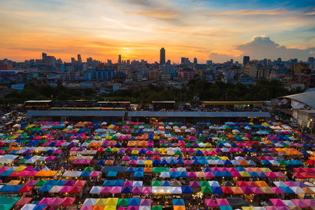 City night market aerial view with city downtown and beautiful after sunset sky background