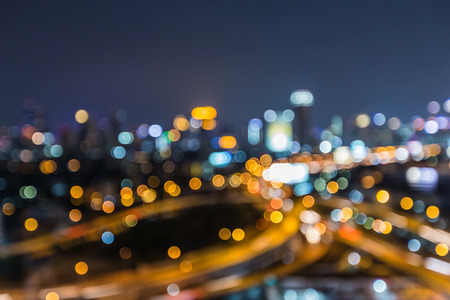 Aerial view, blurred lights highway interchanged with city downtown background, night view Stock Photo