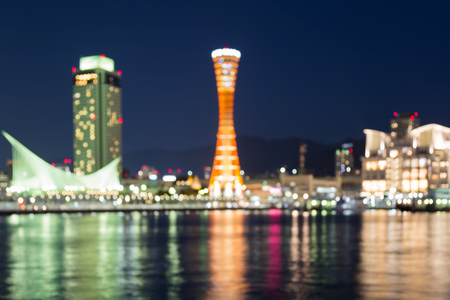 Blurred lights Kobe port city with reflection at night, abstact background