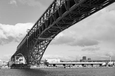 minato: Black and White, Minato Bridge (red bridged) in Osaka port, Japan Stock Photo