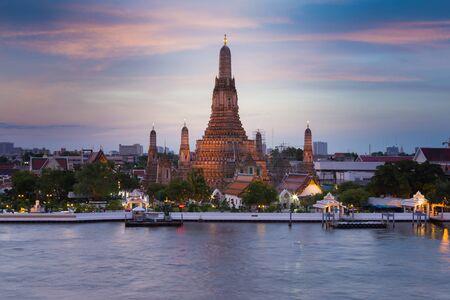 Beautiful twilight sky over Arun Temple river front, Thailand Landmark