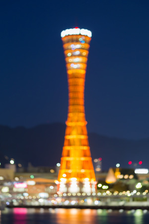 Blurred lights Kobe port tower with twilight sky background Stock Photo