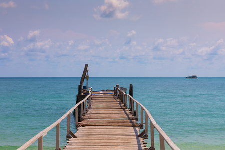 hatteras: Wooden jetty leading to the seacoast, natural coastline landscape