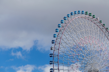 Blue sky over path of large observation Ferris Wheel close up Stock Photo