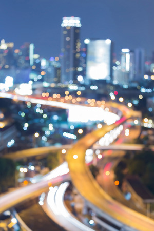 interchanged: Abstract blurred bokeh highway interchanged and office building background night view