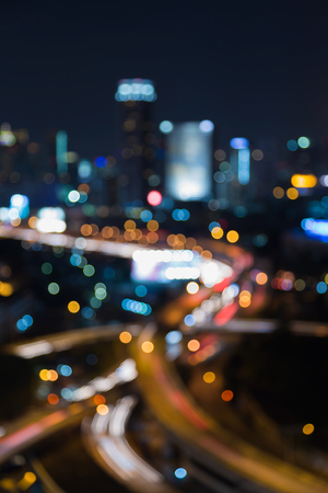 interchanged: Night blurred bokeh light highway interchanged with city office background Stock Photo