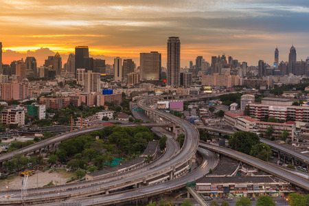 City and interchanged road aerial view with beauty sunset sky background, Bangkok Thailand