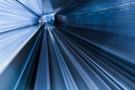 accelerated: Moving train out of tunnel, blurred motion background Stock Photo