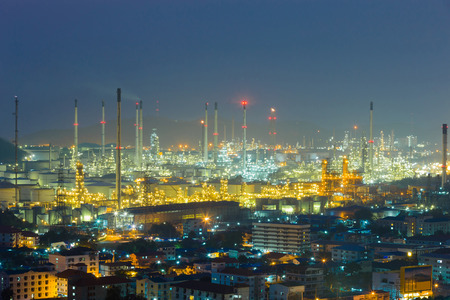 Aerial view Oil refinery with twilight blue sky background