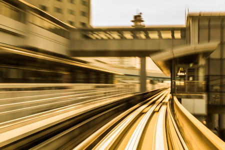 Blurred motion of moving train into tunnel, abstract background