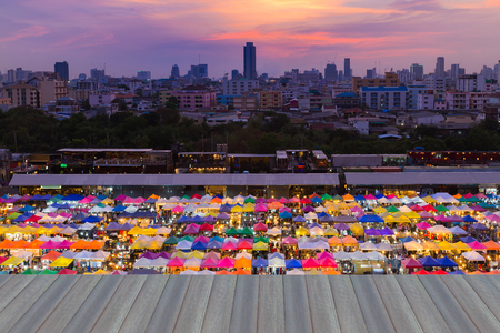 Opening wooden floor, night market roof top with sunset sky background