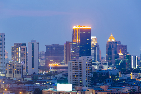 Twilight sky over Bangkok city office building, cityscape background