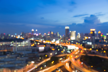 Blurred bokeh light aerial view city highway intersection with twilight sky abstract background Stock Photo