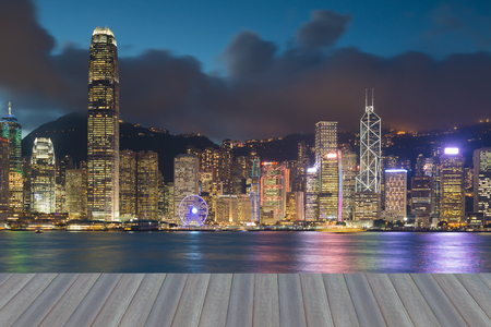 Opening wooden floor, Hong Kong central business downtown night view over Victorial bay