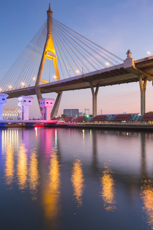 Suspension bridge with water reflection with twilight sky background, Bangkok Thailand