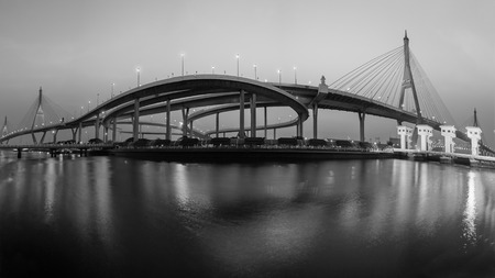 Panorama Suspension bridge with water reflection with twilight sky background, Bangkok Thailand, Black and White tone