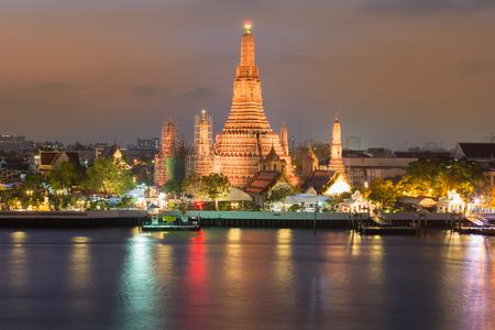 Arun temple watefront with reflection at night, Thailand Landmark Stock Photo