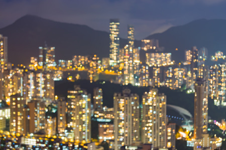 source of light: City apartment blurred bokeh light night view, Hong Kong city downtown, abstract background