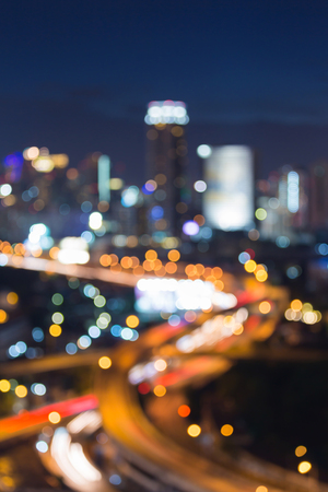 Aerial view blurred bokeh city and highway interchanged light, abstract background