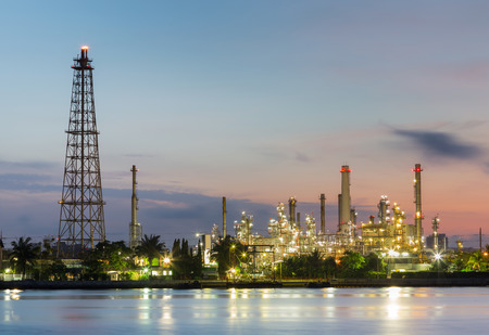 Oil refinery factory with sunrise sky background, industrial landscape background Stock Photo