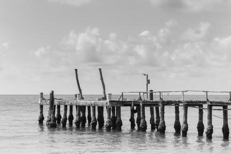 hatteras: Black and White, Long wooden bridge leading to ocean, natural skyline landscape background