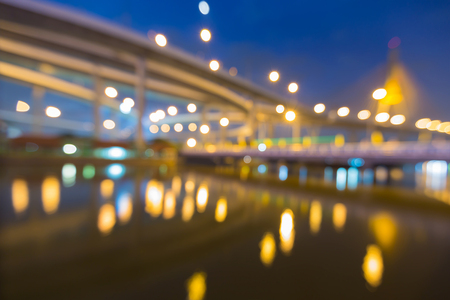Twilight blurred bokeh light highway and suspension bridge, abstract background