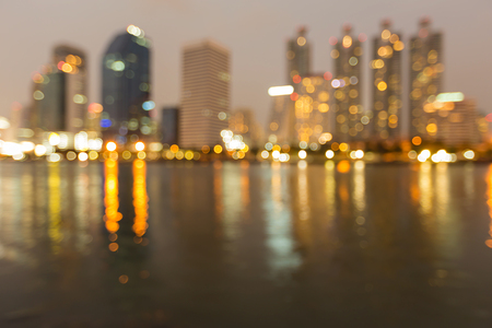 Reflection blurred light office building night view, abstract background