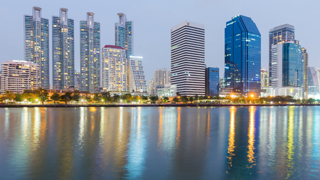 estate: Office building cityscape downtown with water light reflection at twilight