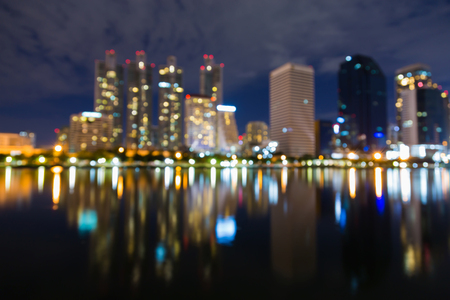 Twilight sky, Office building blurred bokeh light with reflection, abstract background Stock Photo
