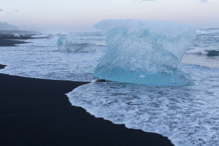 icefjord: Natural black sand beach with Ice breaking on top, Iceland natural winter season landscape background