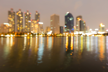 Abstract blurred bokeh light office building water front, abstract background Stock Photo