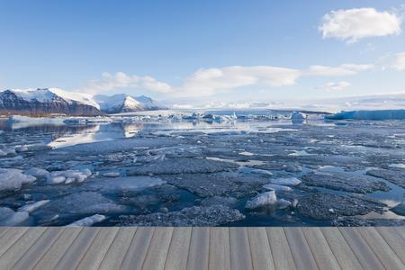 Opening wooden floor, Jakulsarlon lagoon in winter season, Iceland natural landscape background