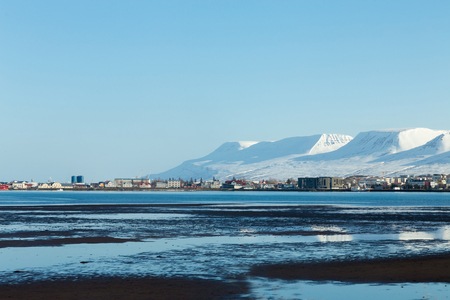 Iceland cityscape over seacoast with show covered mountain winter season landscape backgroud