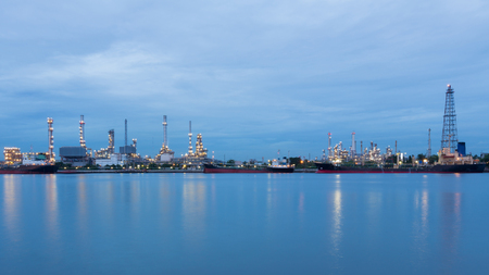 industrail: Industrail petroleum refinery river front at twilight Stock Photo