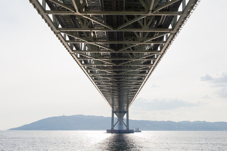 Under Akashi Kaikyo Bridge, an, the longest suspension bridge, in Kobe sea port, Japan