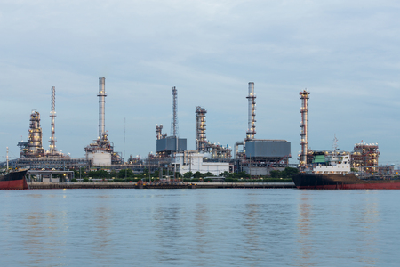 Oil refinery petrol plant water front, Industrial landscape background