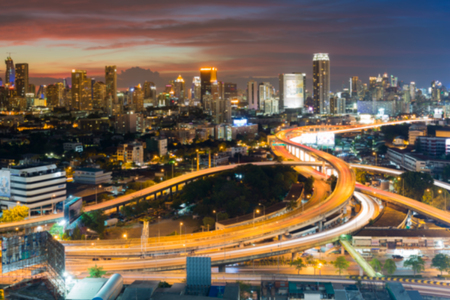 Blurred bokeh city downtown background and highway interchanged aerial view, abstract background Stock Photo
