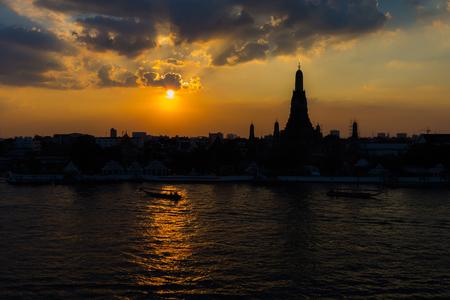 Silhouette over Wat Arun at sunset, Bangkok Thailand Landmark