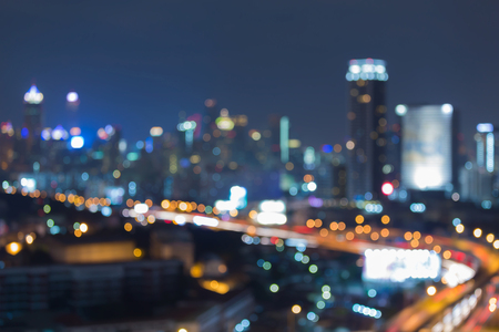 Twilight blurred bokeh light city and road night view, abstract background