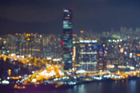 gloom: Blurred night twilight Hong Kong business downtown over Victoria bay, abstract background