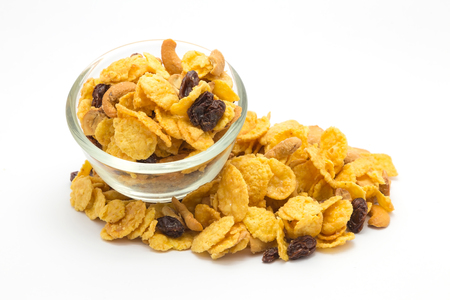 nourishing: Homemade, a glass bowl of honey caramel cornflakes on white background